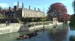 Cambridge punting: boats passing Clare College Stock Footage