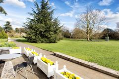 cosy nook with table and chairs in the park - stock photo