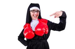 Nun with boxing gloves isolated on white Stock Photos