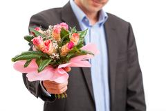man giving flowers - stock photo