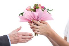 accepting a bouquet - stock photo