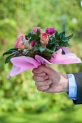 hand with roses - stock photo