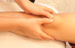 reflexology knee massage, spa knee treatment,thailand - stock photo