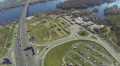 highway  with cars over  river in  city. Aerial top panorama  view Footage