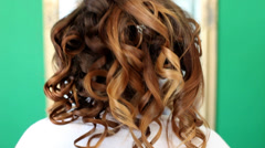 Hairdresser takes out pins from brides hair Stock Footage