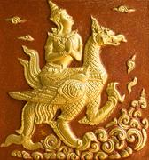 the angle sit on a swan fly on the sky in traditional thai style molding art - stock photo