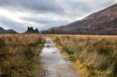 ruins of old medieval castle in scotland - stock photo