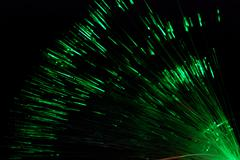 Fiber light in green and red on black Stock Photos