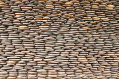Close up of circle pebble wall,abstract background Stock Photos