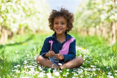 Cute african american little boy playing outdoor - black people Stock Photos