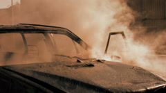 Car on fire. demolition sabotage. emergency disaster background Stock Footage