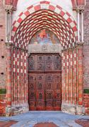 old wooden door at the entrance to catholic church. - stock photo