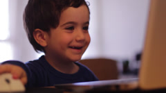 Happy kid or child using computer Stock Footage