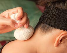 reflexology neck massage, spa the neck treatment by ball-herb,thailand - stock photo