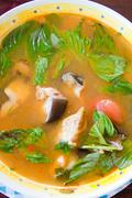thai fish hot and sour soup spicy,made by fish from the khong river - stock photo