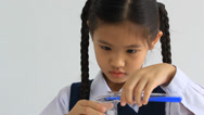 Stock Video Footage of Little Asian student making science experiments. Education.