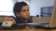 Stock Video Footage of bored child watching content on the web with no parent control