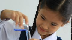 Little Asian student making science experiments. Education. - stock footage