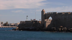 Old Town of Rhodes, view of the Medieval walls on the seashore, zoom out Stock Footage