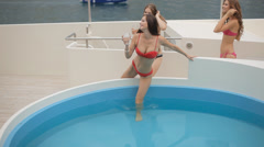 Young women dance steps in the pool. Stock Footage