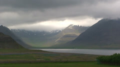 Timelapse of moving cloud cover over fjord Stock Footage