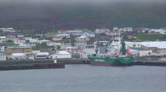 Green ship in arctic ocean port Stock Footage
