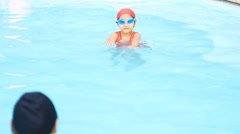 Little Asian child practices swimming with her mother. Asian family. Stock Footage