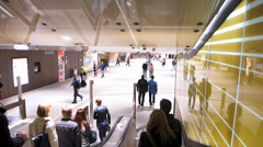 Slow Motion POV Commuters people on escalator down to Metro station Munich Stock Footage