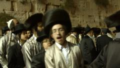 4K+HD Jews dance at the Western Wall during passover holiday Stock Footage