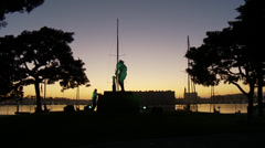 Marina at Dusk with Woman an Statue Stock Footage