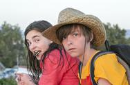 Stock Photo of two teenager on journey, with straw hat and rucksack