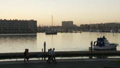 Boat pulls Away at Marina Stock Footage