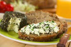 wholegrain bread with goat cheese - stock photo