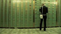 Women withdraw money. locker room save. savings safety. cash Stock Footage
