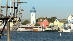 Marina Sailboat and Lighthouse Stock Footage