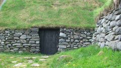 Medieval Viking stone house with turf roof Stock Footage