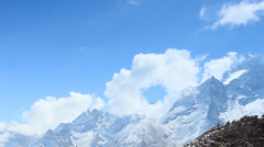 Movement of the clouds on the mountains Himalayas, Khumjung village, Nepal. Stock Footage