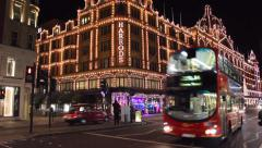 Night traffic in front of Famous department store Harrods Stock Footage