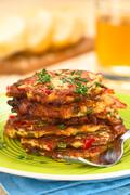 zucchini and bell pepper fritter - stock photo
