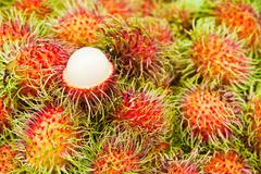 tropical fruit,white pulp rambutan among red rambutan. - stock photo