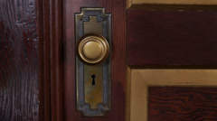 Historic Antique Parlor Gold Door Handle and Skeleton Key Hole Stock Footage