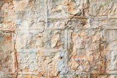 A weathered natural sandstone brick wall Stock Photos