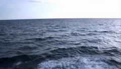 $Glare of the sun and the waves on the sea surface. - stock footage