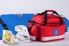 rescue bag, cervical collars and stretcher - stock photo