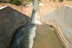 An irrigation canal for agricalture Stock Photos