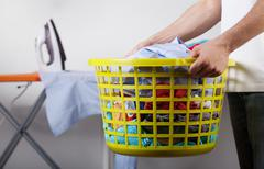 basket with clean clothes - stock photo