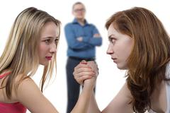 Two girls struggle for man Kuvituskuvat