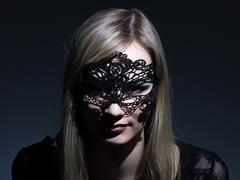 Girl in lace mask - stock photo