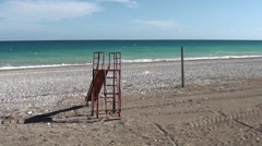 Children slide at the empty beach Stock Footage