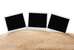 Photoframe on the sea sand Stock Photos
